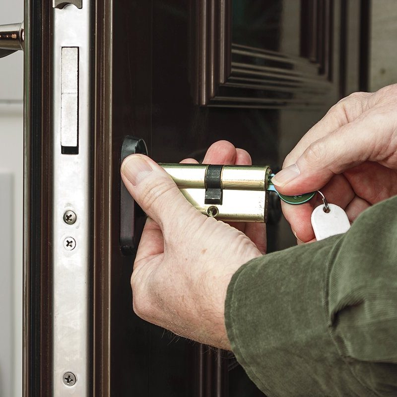Locksmith replacing a cylinder lock